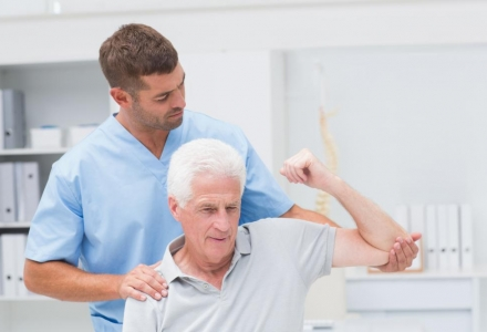 physiotherapist-giving-physical-therapy-to-man