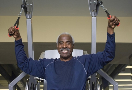 portrait-of-happy-senior-man-exercising-in-gym